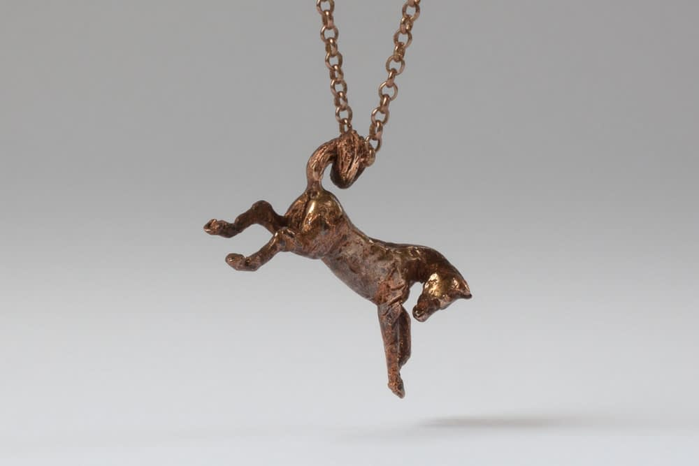 tarnished bronze bucking horse . Liplivivé, sculptural jewellery, pieces of art made to wear and love over a lifetime